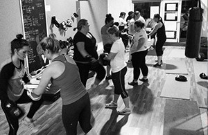 Group of people in an indoor boxing fitness class